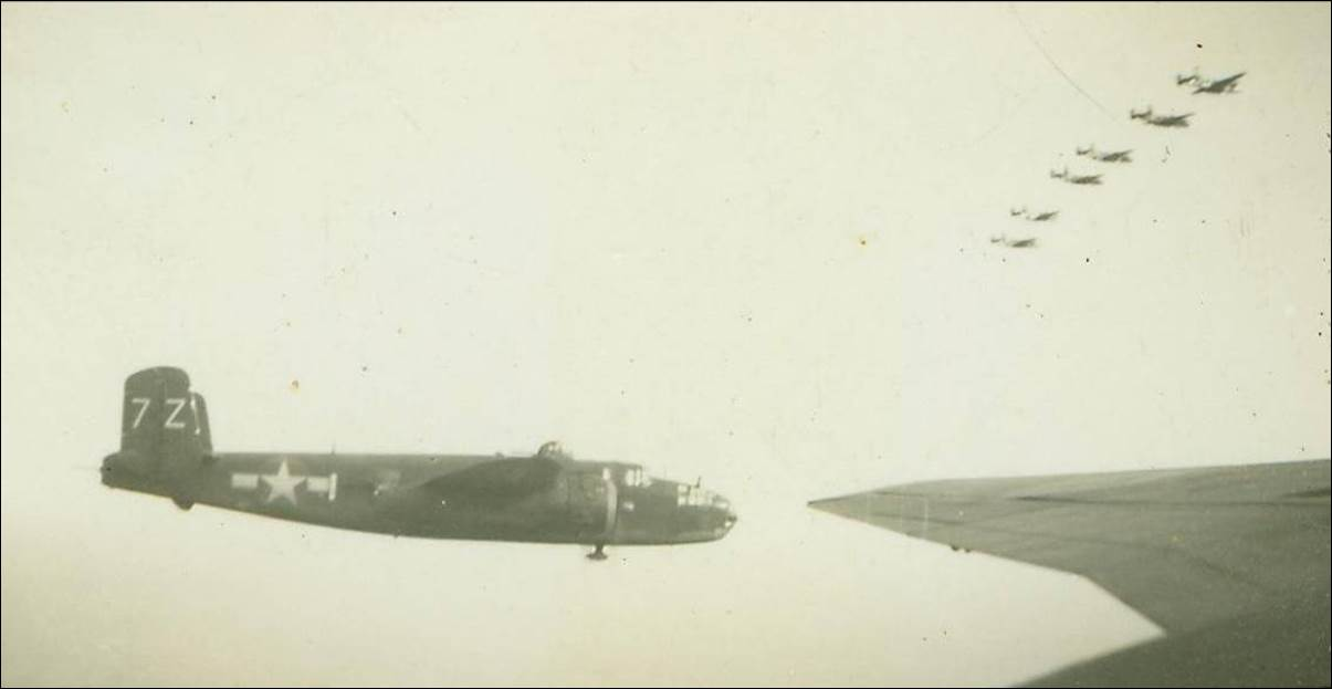 Description: Description: 487th_b_25s_in_formation_7Z