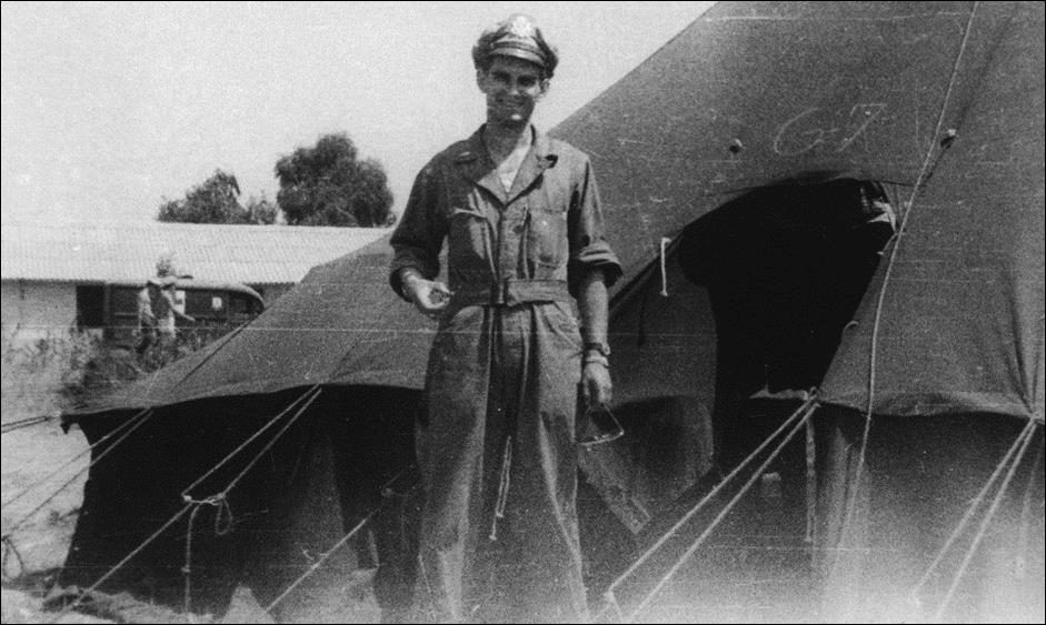 Navigator Dick Alhouse in front of his tent